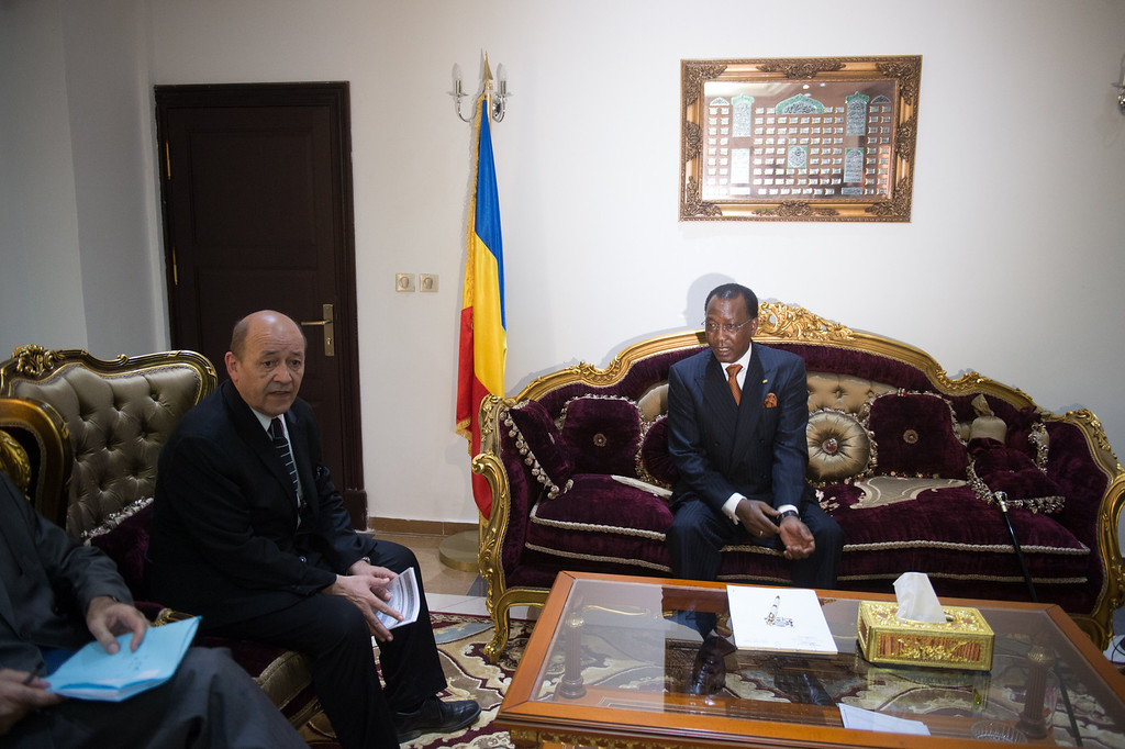 Description of . France's Defence Minister Jean-Yves Le Drian (L) meets with Chad's President Idriss Deby (R) at the presidential palace in N'Djamena on April 27, 2013. Chad should remain militarily involved in Mali, Le Drian said Saturday in N'Djamena on a tour of the region to drum up support for a robust force when his own troops pull out. Mali called on France's help in January to halt an Islamist advance on Bamako and French and African troops have since pushed the Al-Qaeda-linked militants into desert and mountain hideouts, from where they are staging guerrilla attacks. MARTIN BUREAU/AFP/Getty Images
