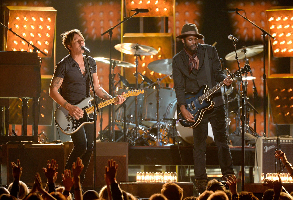 Description of . Musicians Keith Urban (L) and Gary Clark Jr. perform onstage during the 56th GRAMMY Awards at Staples Center on January 26, 2014 in Los Angeles, California.  (Photo by Kevork Djansezian/Getty Images)