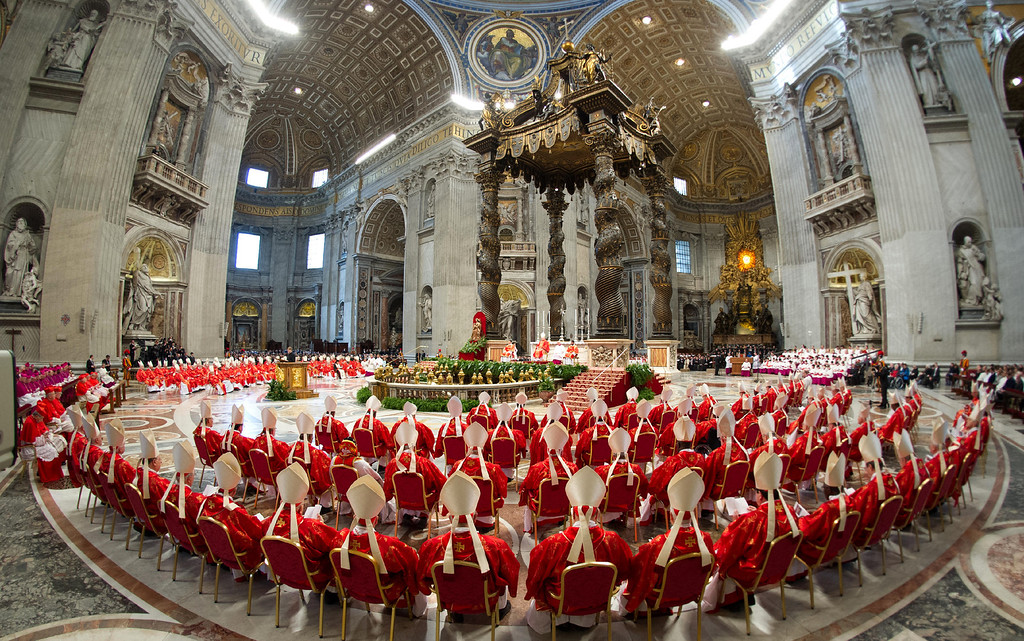 Description of . This handout picture released by the Vatican Press Office on March 12, 2013 shows cardinals following a grand mass at the St Peter\'s basilica before the start of a papal election conclave on March 12, 2013 at the Vatican. AFP PHOTO/OSSERVATORE ROMANO-/AFP/Getty Images