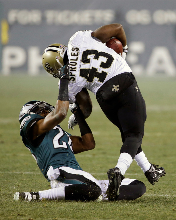 Description of . Philadelphia Eagles' Cary Williams (26) pulls down New Orleans Saints' Darren Sproles (43) by his collar during the second half of an NFL wild-card playoff football game, Saturday, Jan. 4, 2014, in Philadelphia. Williams was penalized for the tackle. (AP Photo/Matt Rourke)