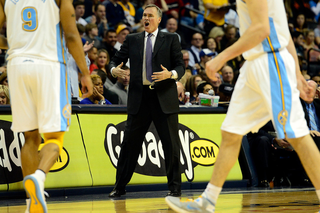 Description of . Los Angeles Lakers head coach Mike D'Antoni shouts at the refs during the second half of the Nuggets' 126-114 win at the Pepsi Center on Wednesday, December 26, 2012. AAron Ontiveroz, The Denver Post