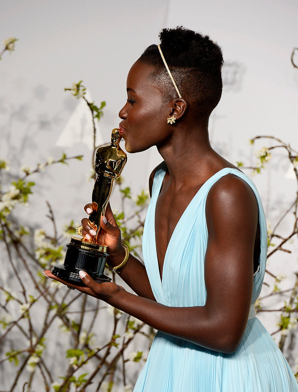 Description of . Kenyan actress Lupita Nyong'o kisses the award for Best Performance by an Actress in a Supporting Role for '12 Years a Slave' in the press room during the 86th annual Academy Awards ceremony at the Dolby Theatre in Hollywood, California, USA, 02 March 2014. The Oscars are presented for outstanding individual or collective efforts in up to 24 categories in filmmaking.  EPA/PAUL BUCK