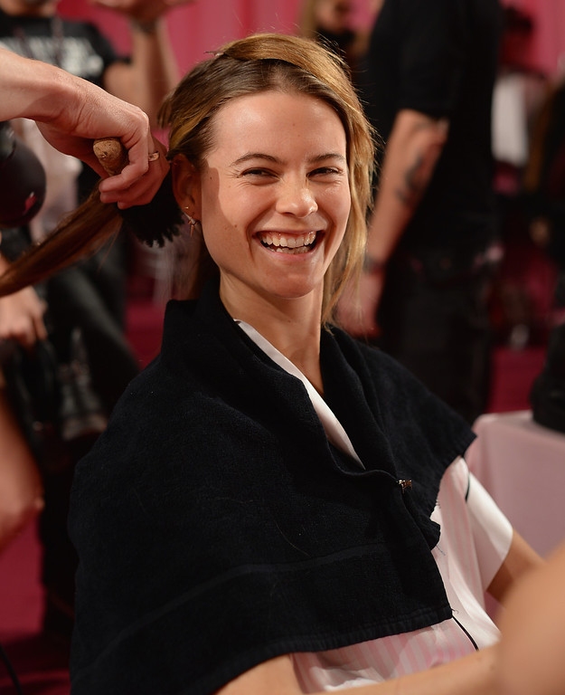 Description of . Model Behati Prinsloo prepares at the 2013 Victoria's Secret Fashion Show hair and make-up room at Lexington Avenue Armory on November 13, 2013 in New York City.  (Photo by Dimitrios Kambouris/Getty Images for Victoria's Secret)