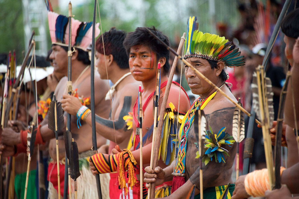 Description of . Indigenous men of various tribes wait to take part in the bow and arrow competition during the XII International Games of Indigenous Peoples in Cuiaba, Mato Grosso state, Brazil on November 12, 2013.  AFP PHOTO / Christophe SIMON/AFP/Getty Images