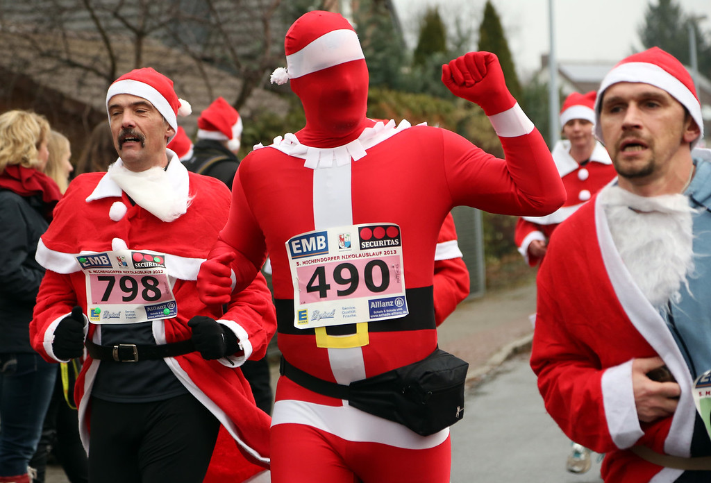 Description of . Participants compete in the 5th annual Michendorf Santa Run (Michendorfer Nikolauslauf) on December 8, 2013 in Michendorf, Germany. Over 900 people took part in this year's races, which included one for children and one for adults.  (Photo by Adam Berry/Getty Images)