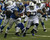Mikel Leshoure #25 of the Detroit Lions tries to run past Kavell Conner #53 of the Indianapolis Colts at Ford Field on December 2, 2012 in Detroit, Michigan.  (Photo by Dave Reginek/Getty Images)