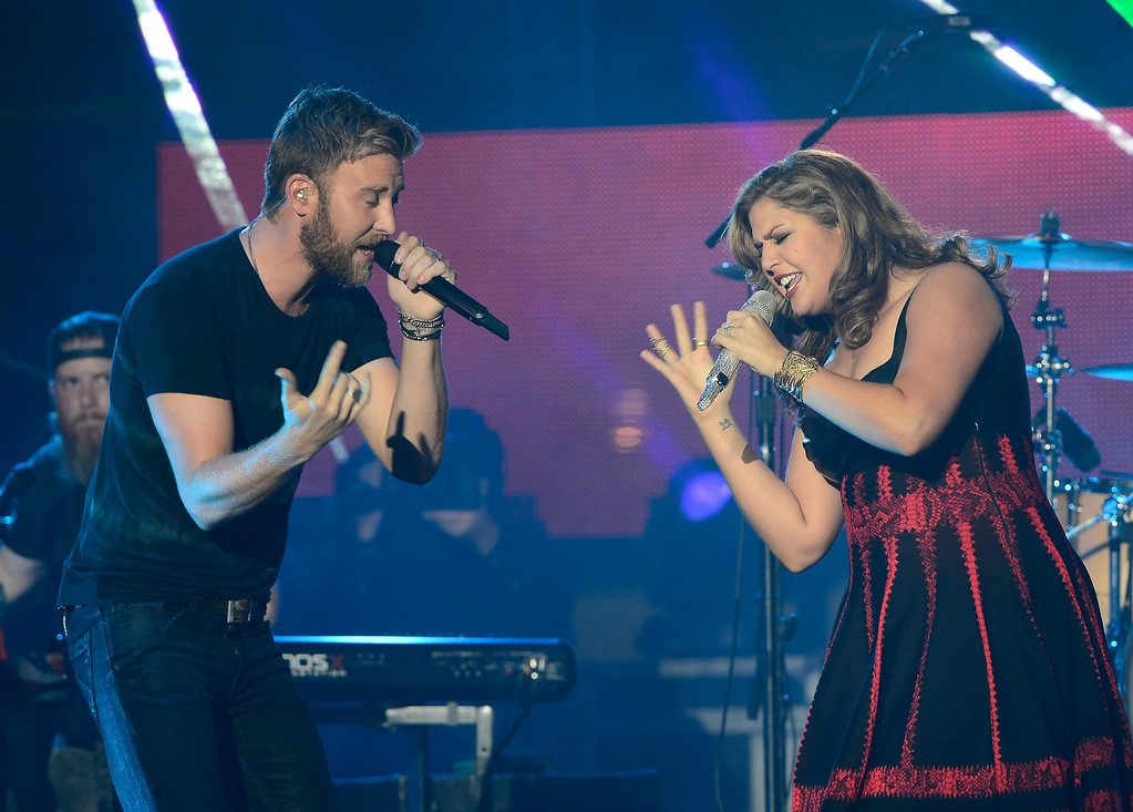 Description of . Lady Antebellum performs on an outdoor stage during the CMT Music Awards on Wednesday, June 4, 2014, in Nashville, Tenn. (Photo by Mark Zaleski/Invision/AP)