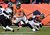 Denver Broncos wide receiver Brandon Stokley (14) gets tackled by Baltimore Ravens inside linebacker Ray Lewis (52) in the second quarter. The Denver Broncos vs Baltimore Ravens AFC Divisional playoff game at Sports Authority Field Saturday January 12, 2013. (Photo by Joe Amon,/The Denver Post)