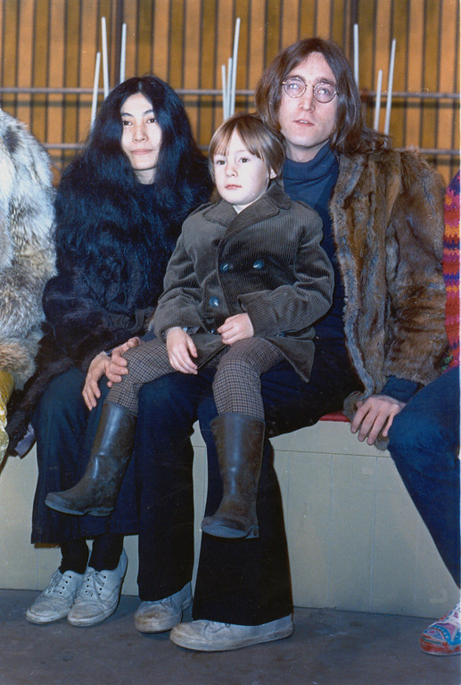 Description of . In this1968 file photo member of British pop band The Beatles John Lennon poses with his son Julian, sitting on his lap, and  Yoko Ono at an unknown location in 1968. The woman who as a child was the basis for the Beatles song
