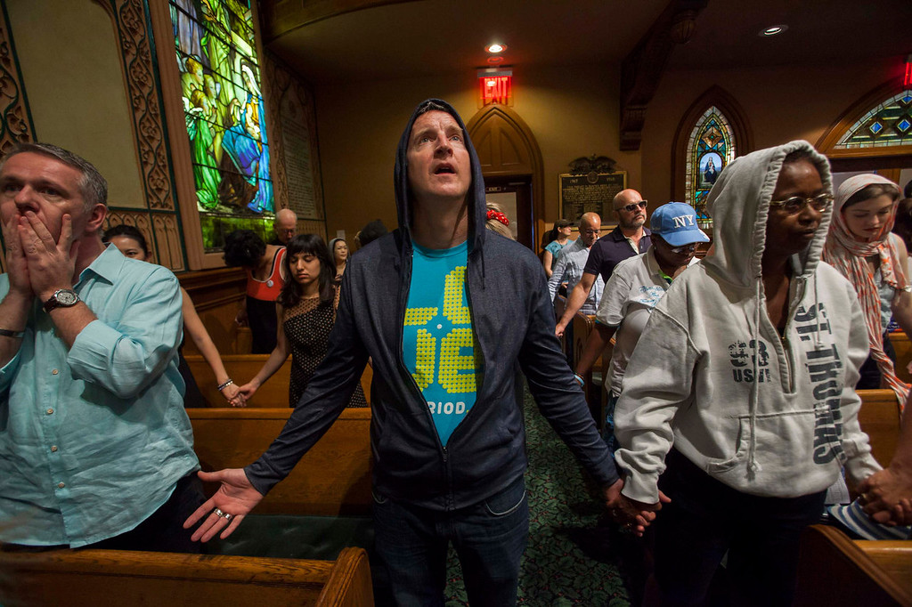 Description of . Worshippers at the Middle Collegiate Church hold prayer services wearing hoodies in support of slain teenager Trayvon Martin in response to the acquittal of George Zimmerman in his trial in New York, July 14, 2013. A Florida jury acquitted Zimmerman on Saturday for the shooting death of unarmed black teenager Martin, setting free a man who had become a polarizing figure in the national debate over racial profiling and self-defense laws. REUTERS/Keith Bedford