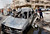 People inspect a car destroyed in a car bomb attack close to one of the main gates to the heavily-fortified Green Zone, which houses major government offices and the embassies of several countries, including the United States and Britain in Baghdad, Iraq, Tuesday, March 19, 2013. (AP Photo/ Hadi Mizban)