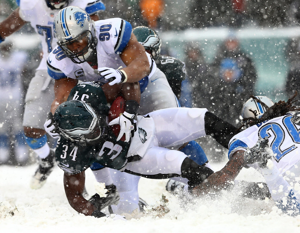 Description of . Bryce Brown #34 of the Philadelphia Eagles is tackled by Ndamukong Suh #90 of the Detroit Lions on December 8, 2013 at Lincoln Financial Field in Philadelphia, Pennslyvania.  (Photo by Elsa/Getty Images)