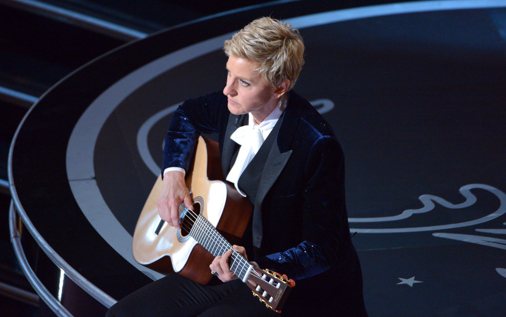 Description of . Ellen DeGeneres performs during the Oscars at the Dolby Theatre on Sunday, March 2, 2014, in Los Angeles.  (Photo by John Shearer/Invision/AP)