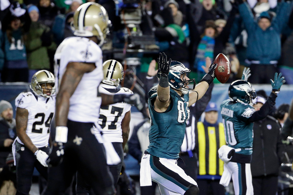 Description of . Philadelphia Eagles' Zach Ertz (86) celebrates after scoring a touchdown during the second half of an NFL wild-card playoff football game against the New Orleans Saints, Saturday, Jan. 4, 2014, in Philadelphia. (AP Photo/Matt Rourke)