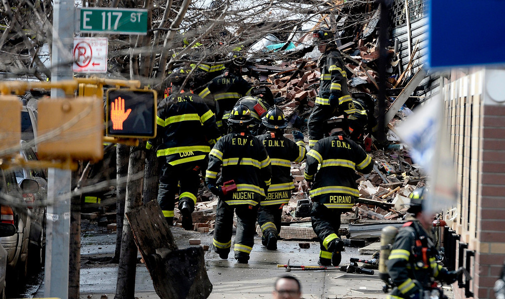 Description of . Firefighters on the scene where a group of buildings were damaged by fire and a possible explosion in New York, New York, USA, 12 March 2014.  EPA/ANDREW GOMBERT