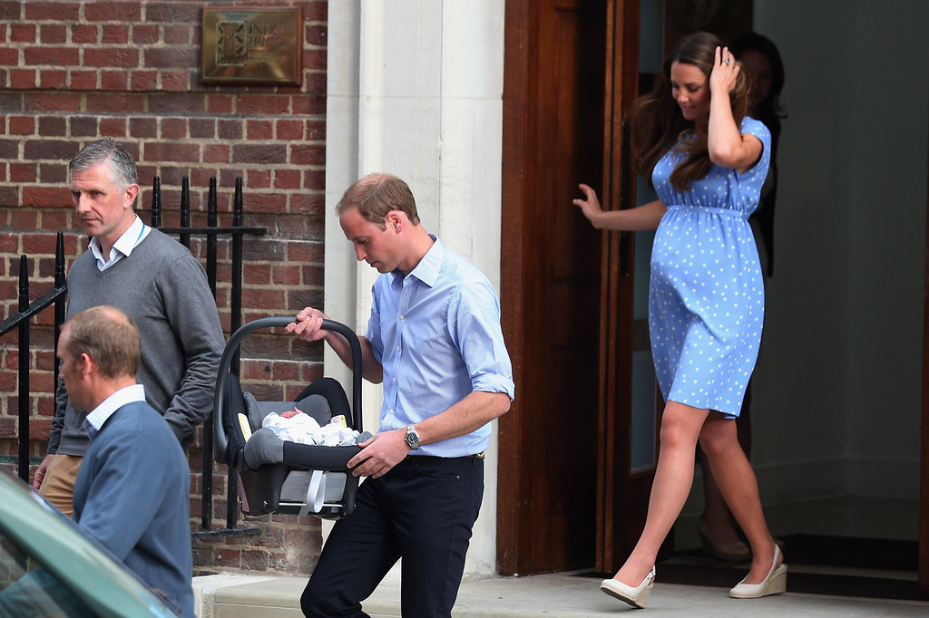 Description of . Prince William, Duke of Cambridge and Catherine, Duchess of Cambridge leave the Lindo Wing of St Mary\'s Hospital with their newborn son on July 23, 2013 in London, England.  The Duchess of Cambridge yesterday gave birth to a boy at 16.24 BST and weighing 8lb 6oz, with Prince William at her side. The baby, as yet unnamed, is third in line to the throne and becomes the Prince of Cambridge.  (Photo by Oli Scarff/Getty Images)