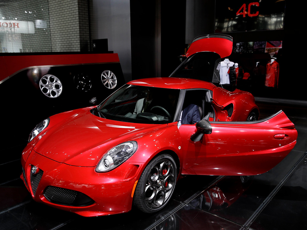 Description of . An Alfa Romeo 4C is displayed at the New York International Auto Show in New York, Thursday, April 17, 2014.  (AP Photo/Seth Wenig)