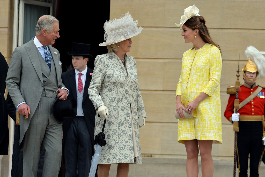 Description of . Prince Charles, the Prince of Wales (L), Camilla, the Duchess of Cornwall (C) and Catherine, the Duchess of Cambridge attend a Garden Party in the grounds of Buckingham Palace, central London on May 22, 2013.  JOHN STILLWELL/AFP/Getty Images