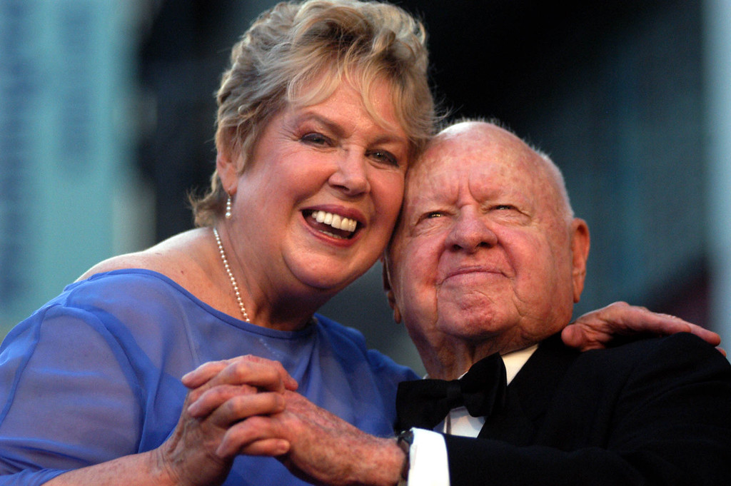 Description of . In this Monday, April 26, 2004, file photo, Jan, left, and Mickey Rooney pose for photographs after having unveiled their star on the Hollywood Walk of Fame in Los Angeles. (AP Photo/Ann Johansson, File)