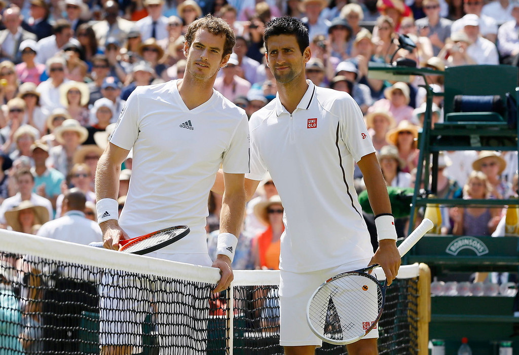 Description of . Andy Murray of Britain, left, and Novak Djokovic of Serbia pose for photographers at the net before the Men's singles final match at the All England Lawn Tennis Championships in Wimbledon, London, Sunday, July 7, 2013. (AP Photo/Kirsty Wigglesworth)
