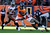 Denver Broncos running back Knowshon Moreno #27 running during the second quarter as Tampa Bay Buccaneers free safety Ahmad Black #43 reaches o stop him. The Denver Broncos vs The Tampa Bay Buccaneers at Sports Authority Field Sunday December 2, 2012. Tim Rasmussen, The Denver Post