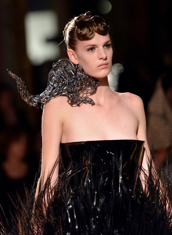 Description of . A model wears a creation by Dutch fashion designer Iris van Herpen for her Spring Summer 2013 Haute Couture fashion collection, presented in Paris, Monday, Jan.21, 2013. (AP Photo/Benjamin Girette)