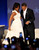 President Barack Obama looks as first lady Michelle Obama straightens out her gown during their dance at the Western Inaugural Ball in Washington, Tuesday, Jan. 20, 2009. (AP Photo/Lawrence Jackson)