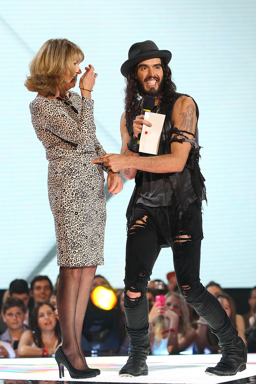 Description of . Russell Brand presents the ARIA for best female artist on stage with his mother Barbara Brand at the 26th Annual ARIA Awards 2012 at the Sydney Entertainment Centre on November 29, 2012 in Sydney, Australia.  (Photo by Don Arnold/Getty Images)