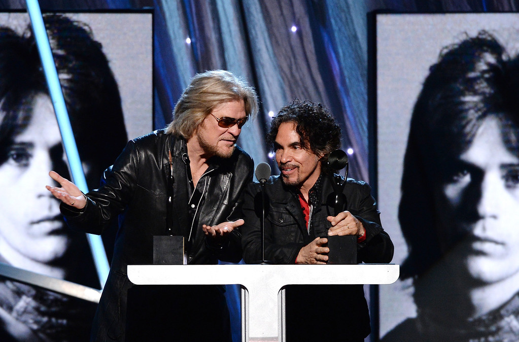 Description of . Inductees Daryl Hall (L) and John Oates of Hall and Oates speak onstage at the 29th Annual Rock And Roll Hall Of Fame Induction Ceremony at Barclays Center of Brooklyn on April 10, 2014 in New York City.  (Photo by Larry Busacca/Getty Images)