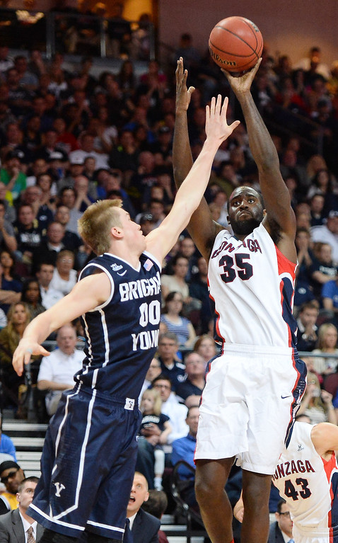 Description of . Sam Dower #35 of the Gonzaga Bulldogs shoots against Eric Mika #00 of the Brigham Young Cougars during the championship game of the West Coast Conference Basketball tournament at the Orleans Arena on March 11, 2014 in Las Vegas, Nevada.  (Photo by Ethan Miller/Getty Images)