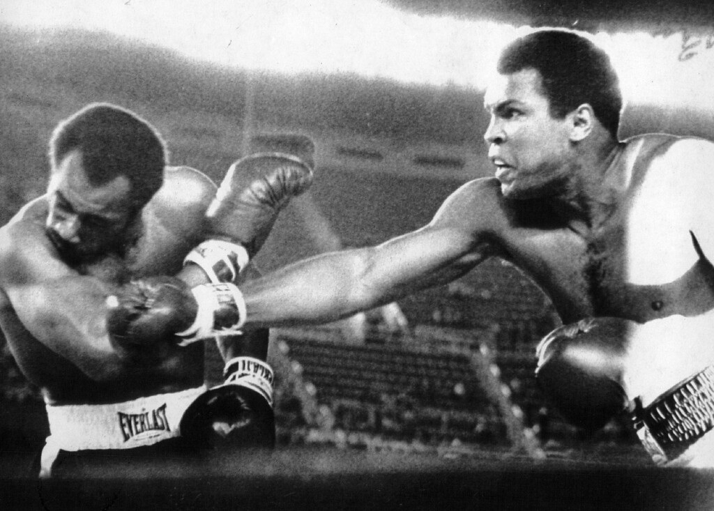 Description of . Muhammad Ali drives a right to the head of Ken Norton in the second round of their heavyweight title bout 9/28/76. Denver Post Library photo archive
