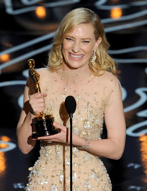 Description of . Actress Cate Blanchett accepts the Best Performance by an Actress in a Leading Role award for 'Blue Jasmine' onstage during the Oscars at the Dolby Theatre on March 2, 2014 in Hollywood, California.  (Photo by Kevin Winter/Getty Images)