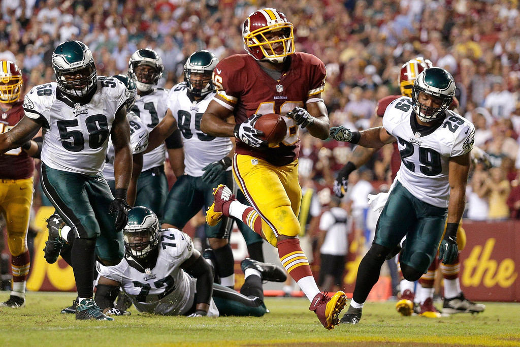 Description of . Washington Redskins running back Alfred Morris carries the ball into the end zone for a touchdown during the second half of an NFL football game against the Philadelphia Eagles in Landover, Md., Monday, Sept. 9, 2013. (AP Photo/Patrick Semansky)