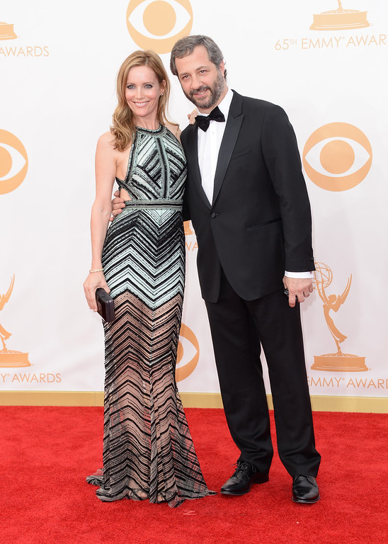 Description of . Actress Leslie Mann (L) and husbnd Director Judd Apatow arrive at the 65th Annual Primetime Emmy Awards held at Nokia Theatre L.A. Live on September 22, 2013 in Los Angeles, California.  (Photo by Jason Merritt/Getty Images)