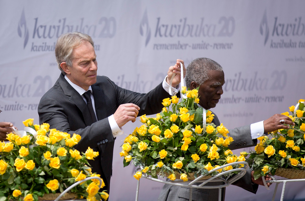 Description of . Former British Prime Minister Tony Blair, left, and Former South African President Thabo Mbeki, right, lay a memorial wreath at a ceremony to mark the 20th anniversary of the Rwandan genocide, held at the Kigali Genocide Memorial Center in Kigali, Rwanda Monday, April 7, 2014. (AP Photo/Ben Curtis)
