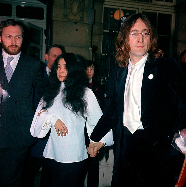 Description of . Beatle John Lennon, right, and companion Yoko Ono are arrested for possession of marijuana after their flat was raided in London, England, on Oct. 18, 1968.  (AP Photo/Boyton)