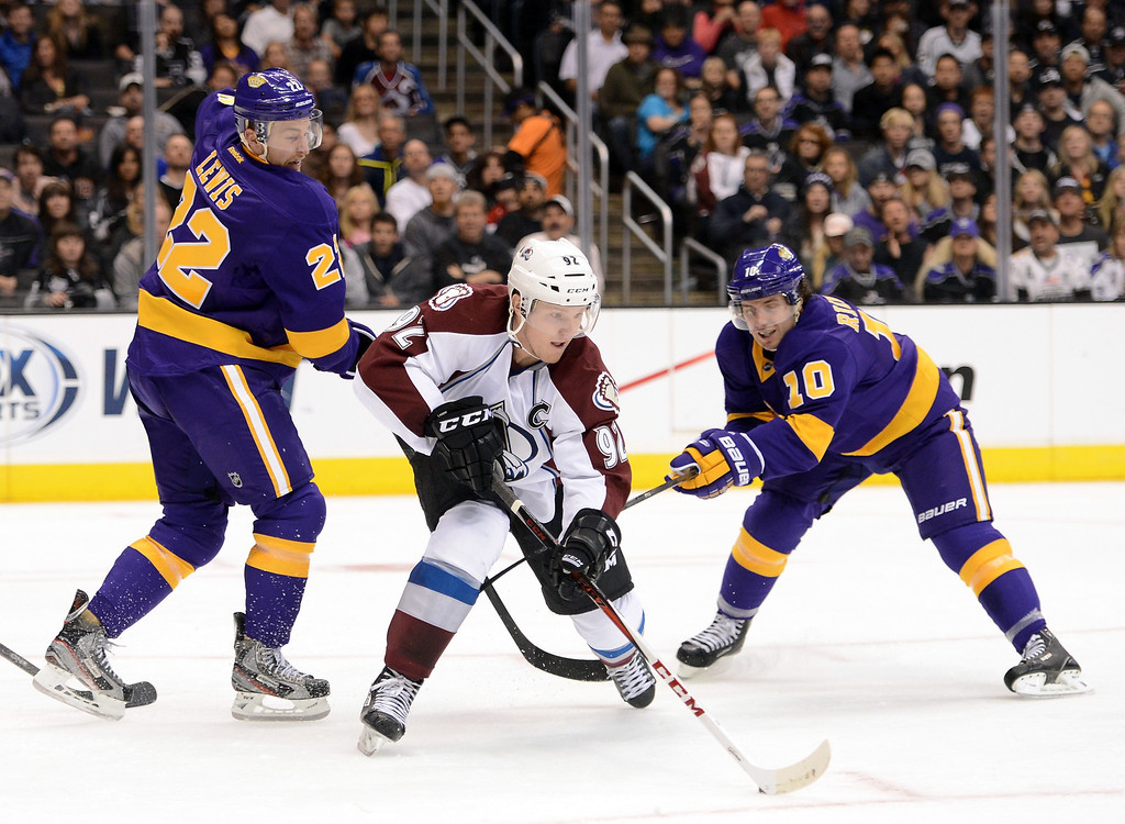 Description of . LOS ANGELES, CA - FEBRUARY 23:  Gabriel Landeskog #92 of the Colorado Avalanche controls a rebound away from Trevor Lewis #22 and Mike Richards #10 of the Los Angeles Kings during the second period at Staples Center on February 23, 2013 in Los Angeles, California.  (Photo by Harry How/Getty Images)