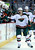 Minnesota Wild right wing Cal Clutterbuck celebrates a goal against the Colorado Avalanche with teammates on the bench during the first period of an NHL hockey game on Saturday, March 16, 2013, in Denver. (AP Photo/Jack Dempsey)