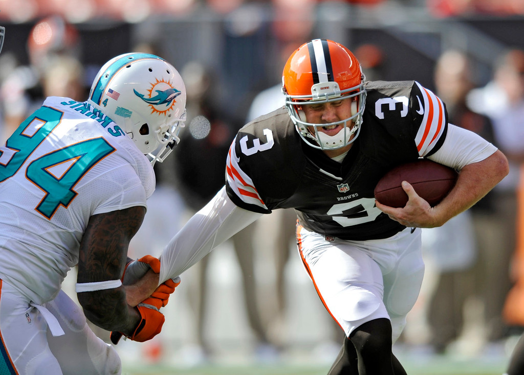 Description of . Cleveland Browns quarterback Brandon Weeden (3) is sacked by Miami Dolphins defensive tackle Randy Starks (94) in the fourth quarter of an NFL football game Sunday, Sept. 8, 2013, in Cleveland. Weeden was sacked five time in the Browns' 23-10 loss to Miami. (AP Photo/David Richard)