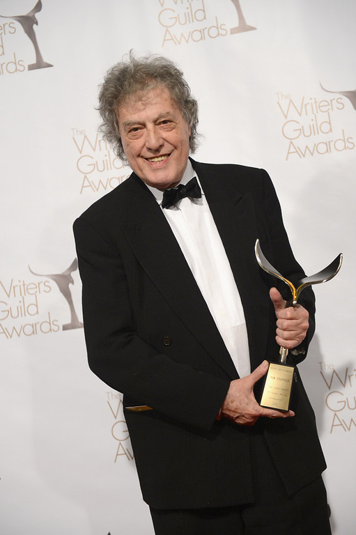 Description of . Writer Tom Stoppard poses with The Laurel Award for Screen Writing Achievement  in the press room during the 2013 WGAw Writers Guild Awards at JW Marriott Los Angeles at L.A. LIVE on February 17, 2013 in Los Angeles, California.  (Photo by Jason Kempin/Getty Images for WGAw)