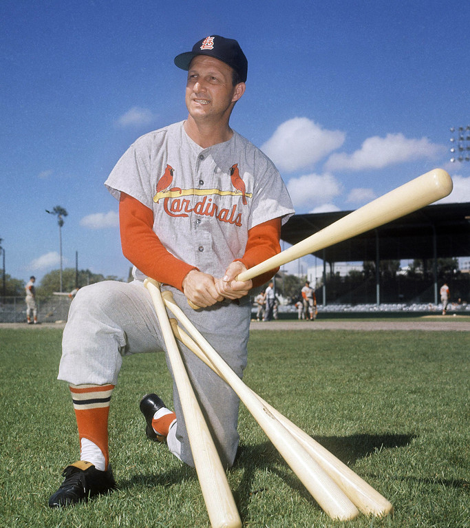 Description of . FILE- In this March 23, 1964 file photo, Stan Musial visits his former teammates at the St. Louis Cardinals spring training baseball camp in Florida. Musial, one of baseball's greatest hitters and a Hall of Famer with the Cardinals for more than two decades, died Saturday, Jan. 19, 2013, the team announced. He was 92.  (AP Photo/File)