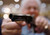 Antique gun collector Richard Kravarik poses with an antique hand gun during the East Coast Fine Arms Show in Stamford, Connecticut, January 5, 2013. REUTERS/Carlo Allegri