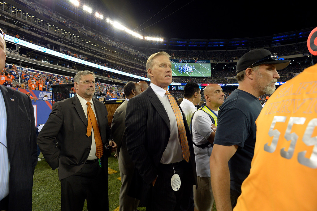 Description of . Denver Broncos Executive V.P. of Football Operations John Elway looks on during the fourth quarter September 15, 2013 MetLife Stadium. (Photo by John Leyba/The Denver Post)