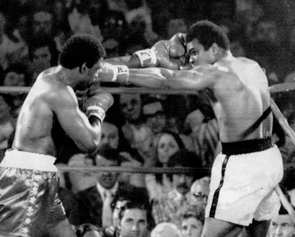 Description of . Exchanging JABS - Muhammad Ali, right, delivers a jab to the face of Ron Lyle during an exchange of punches in the first round to their title fight in Las Vegas Friday night. 1975. Denver post Library Archive