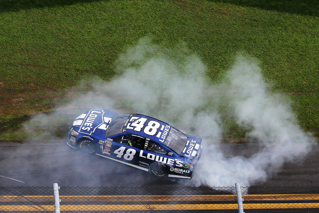 Description of . Jimmie Johnson, driver of the #48 Lowe's Chevrolet, celebrates winning the NASCAR Sprint Cup Series Daytona 500 at Daytona International Speedway on February 24, 2013 in Daytona Beach, Florida.  (Photo by Jonathan Ferrey/Getty Images)