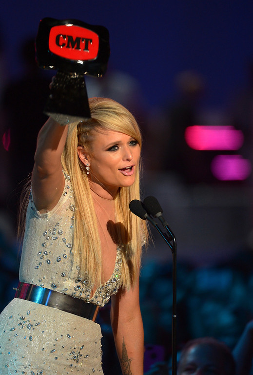 Description of . Miranda Lambert accepts an award onstage at the 2014 CMT Music Awards at Bridgestone Arena on June 4, 2014 in Nashville, Tennessee.  (Photo by Michael Loccisano/Getty Images for CMT)