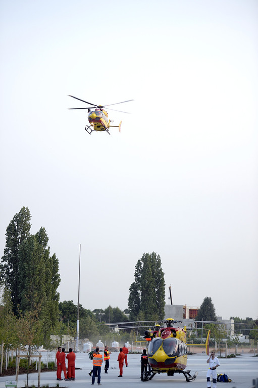 Description of . A helicopter takes to the air as rescuers prepare to evacuate victims on the site of a train accident on July 12, 2013 at the railway station of Bretigny-sur-Orge, near Paris.  AFP PHOTO / MARTIN  BUREAU/AFP/Getty Images