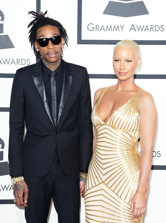 Description of . Rapper Wiz Khalifa (L) and model Amber Rose attend the 56th GRAMMY Awards at Staples Center on January 26, 2014 in Los Angeles, California.  (Photo by Jason Merritt/Getty Images)