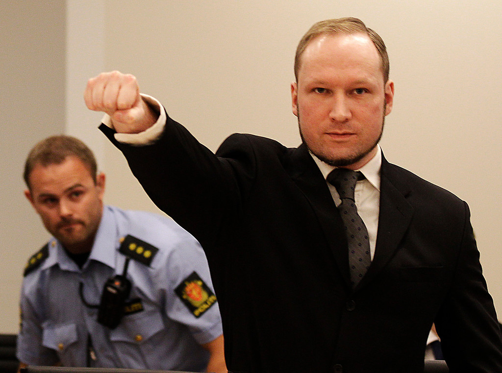 Description of . In this Aug. 24, 2012 file photo, mass murderer Anders Behring Breivik, makes a salute after arriving in the court room at a courthouse in Oslo.   Breivik, who admitted killing 77 people in Norway last year, was declared sane and sentenced to prison for bomb and gun attacks. (AP Photo/Frank Augstein, File)