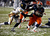 Jerome Smith #45 of the Syracuse Orange runs by Pat Miller #6 of the West Virginia Mountaineers during the New Era Pinstripe Bowl at Yankee Stadium on December 29, 2012 in the Bronx borough of New York City.  (Photo by Jeff Zelevansky/Getty Images)